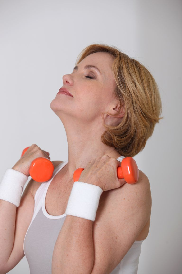 Woman does neck exercise