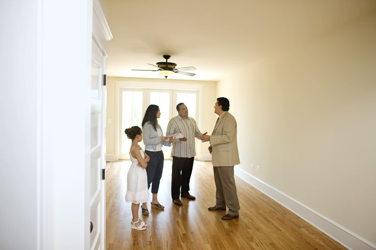 Family with realtor in new home
