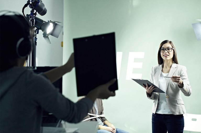 Female presenter during shooting of TV show