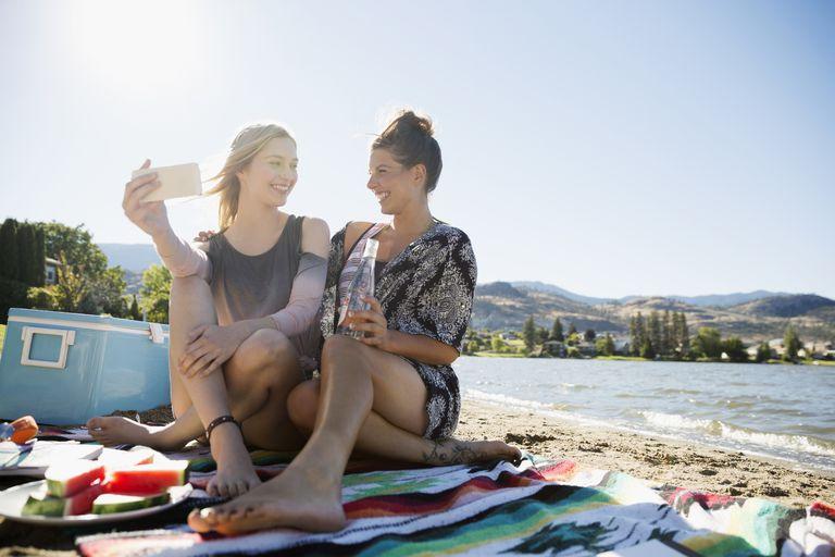 female couple having picnic