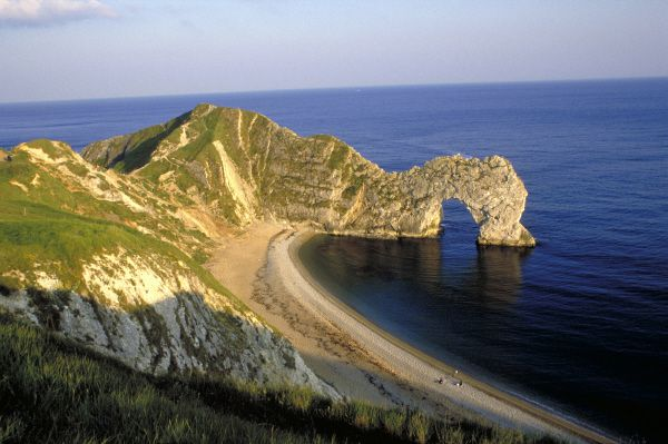 Natural stone arch known as Durdle Door on the Jurassic Coast in Dorset