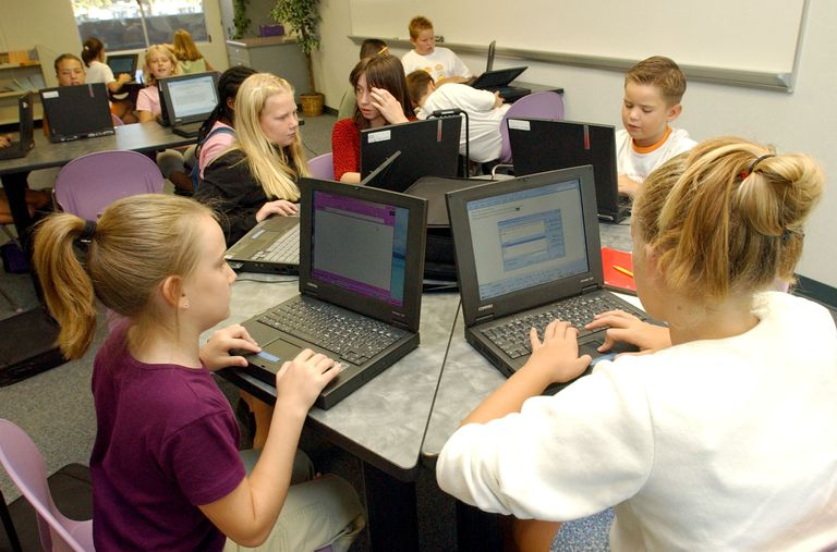 Figure 1-1: A screen shot of children at a school using computers.
