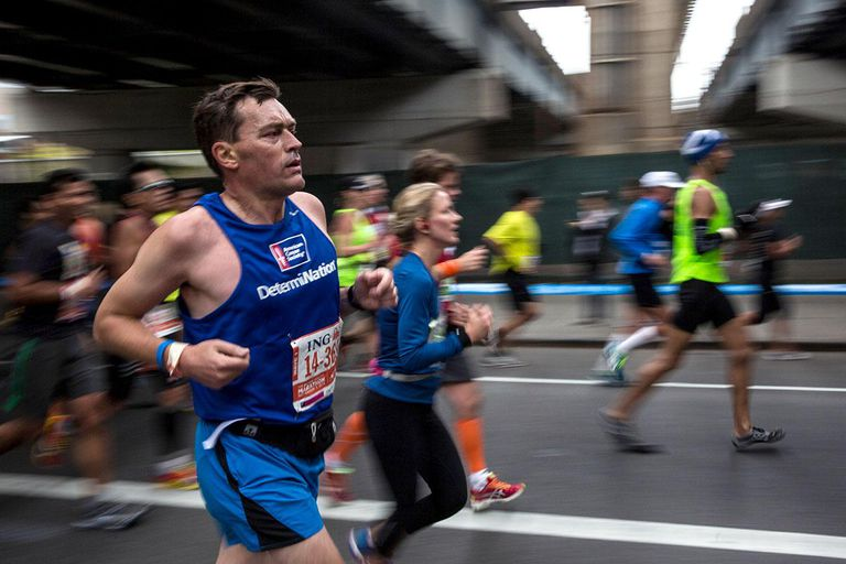 A man runs underneath the Williamsburg Bridge while running the ING New York City Marathon on November 3, 2013 in the Williamsburg neighborhood of the Brooklyn Borough of New York City. With the Boston Marathon bombing from earlier this year still fresh in many minds, security is especially high this year at the New York City marathon.