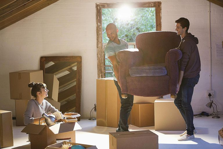 Friends volunteer their time to help another move into a new house