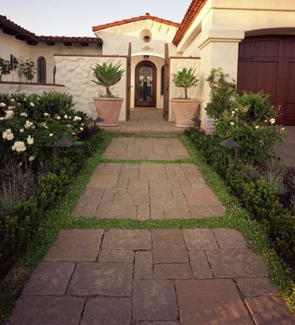 Front Walkway With Pavers Interspersed with Ground Cover