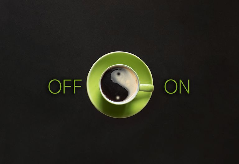 Directly Above Shot Of Coffee Cup With Off And On Text Over Black Background