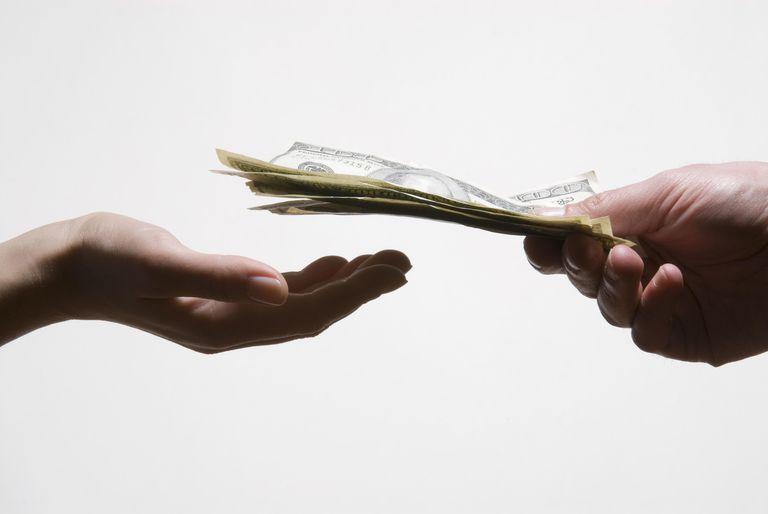 Man handing woman money