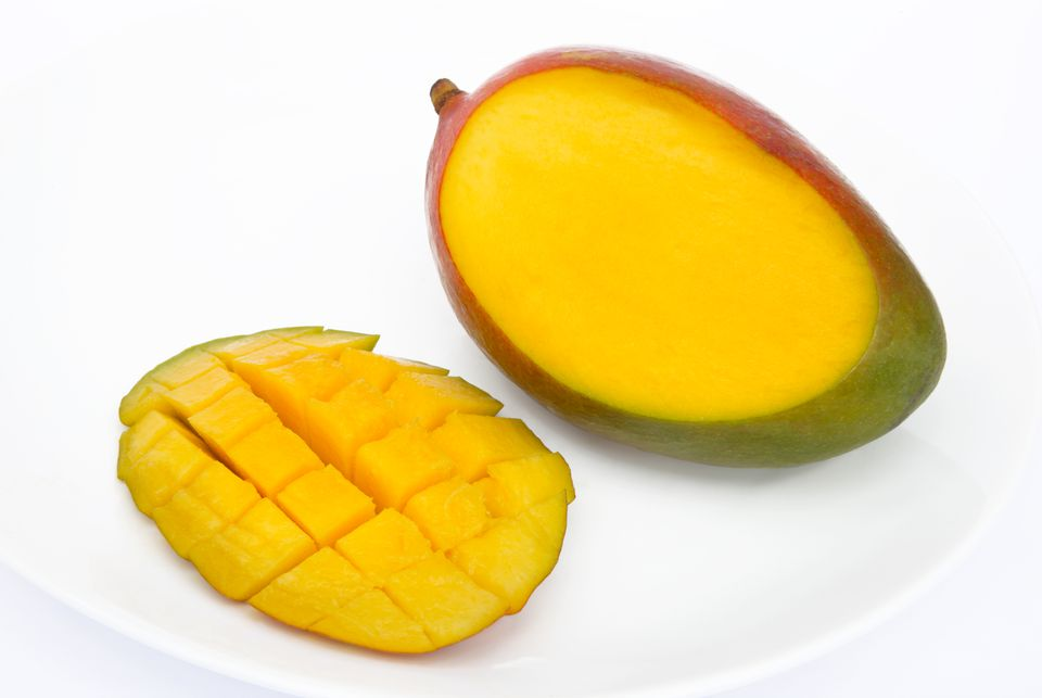Mango cutting and cubing instructions slice cut from a juicy ripe mango ready to eat ccuart Choice Image