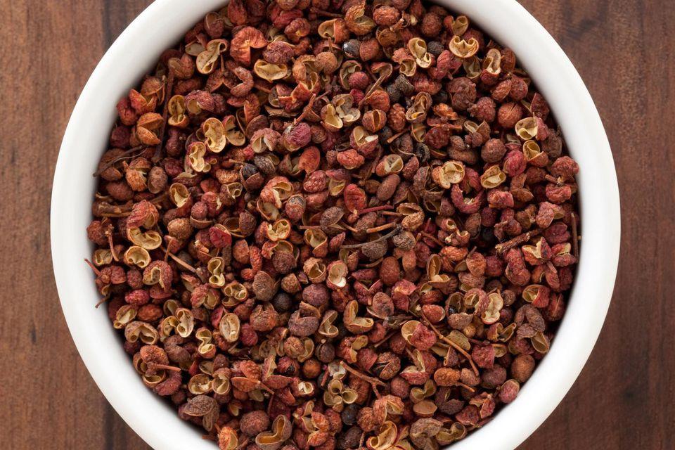 White bowl full of szechuan peppercorns