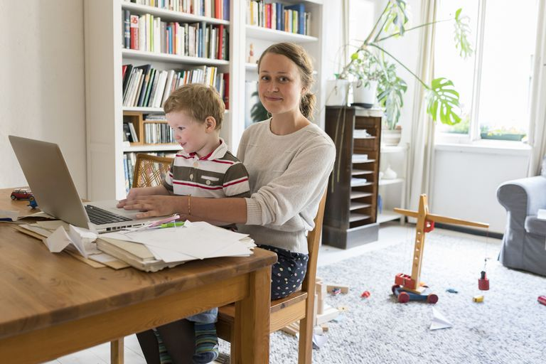 Female professional and son working at home office
