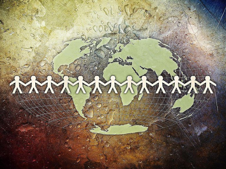 Human chain around the world, symbolizing the definition of globalization.