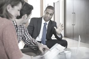 Financial advisor speaking with clients.