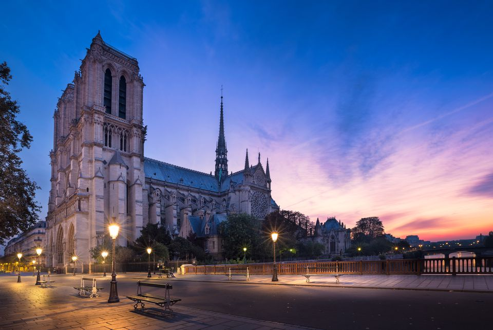 Notre Dame cathedral at night in Paris, France.