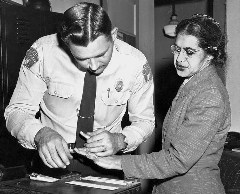 A picture of Rosa Parks being fingerprinted after she was arrested for not giving up her bus seat.