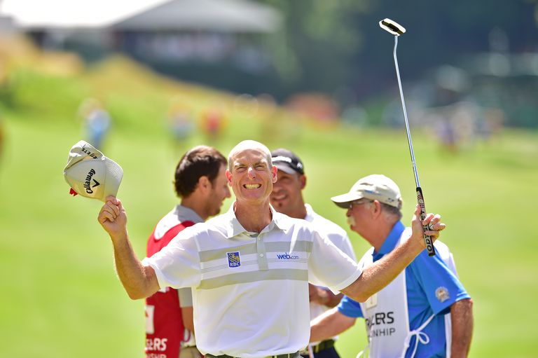 Jim Furyk celebrates after shooting a record setting 58 during the final round of the 2016 Travelers Championship