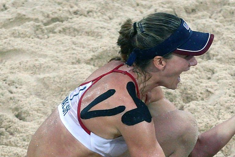 Kerri Walsh and Misty May-Treanor of the United States celebrate winning match point against Wang Jie and Tian Jia of China in the women's beach volleyball gold medal match held at the Chaoyang Park Beach Volleyball Ground during Day 13 of the Beijing 2008 Olympic Games on August 21, 2008 in Beijing, China.