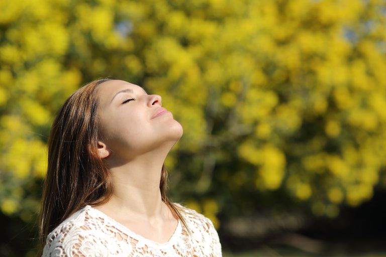woman taking deep breath of air