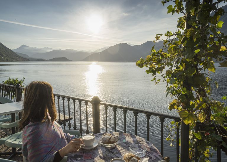 Woman having Cappuccino on Lake Como