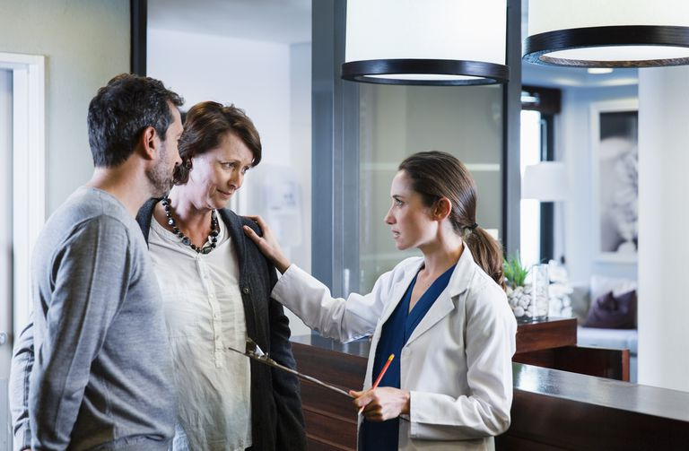 doctor having serious conversation with couple