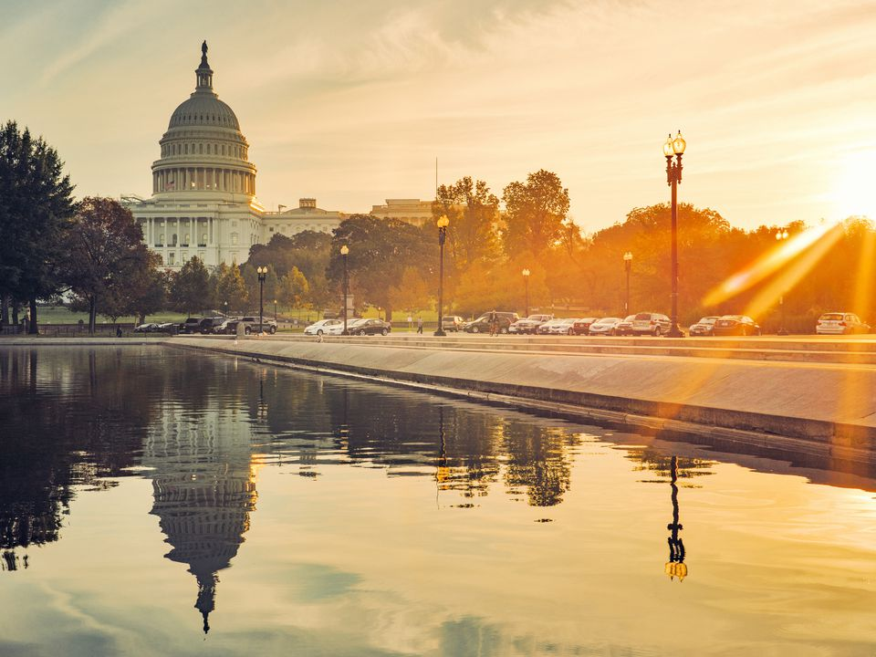 Capitol Building and Reflecting Pool in Washington D.C, USA at sunrise