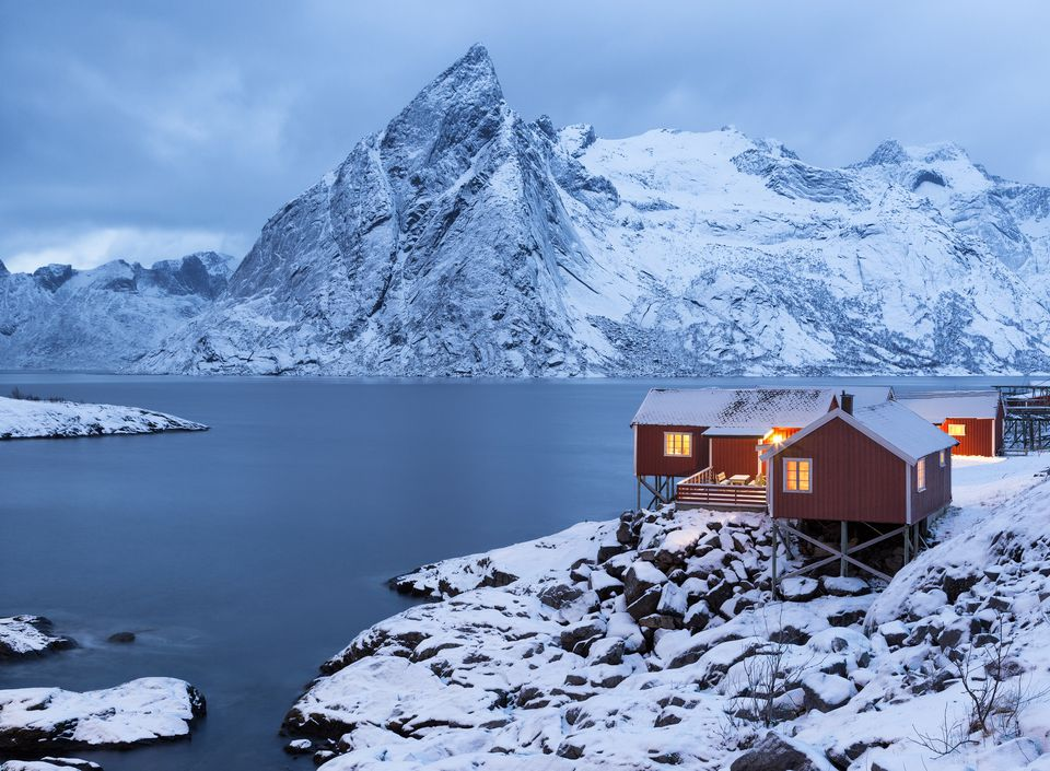 A view of the Eliassen Rorbuer cabins during blue hour in the Lofoten Islands in Norway