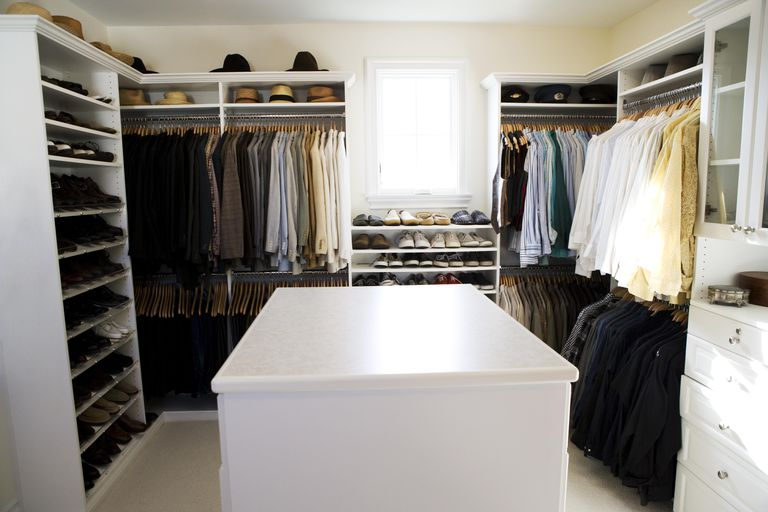 Walk in master closet in master bedroom of home