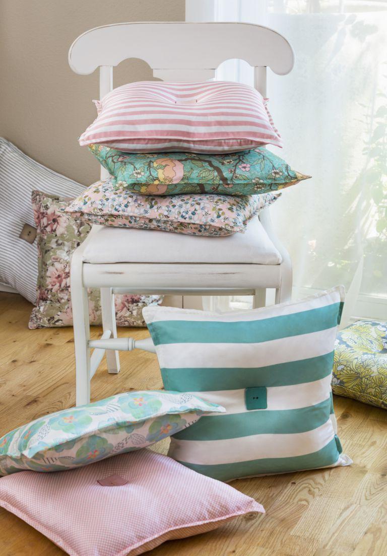 Cu ntos cojines debes usar al decorar for Pisos en silla de bancos