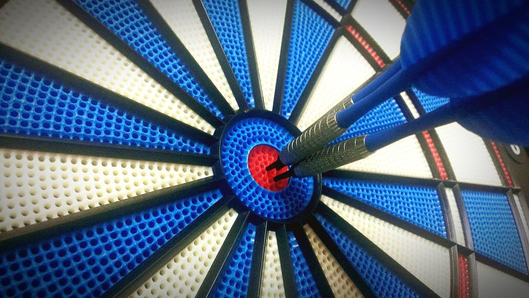 Close-Up Of Darts On Target