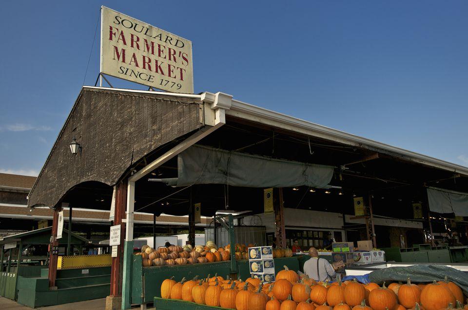 Soulard farmer's market sign and pumpkins for sale