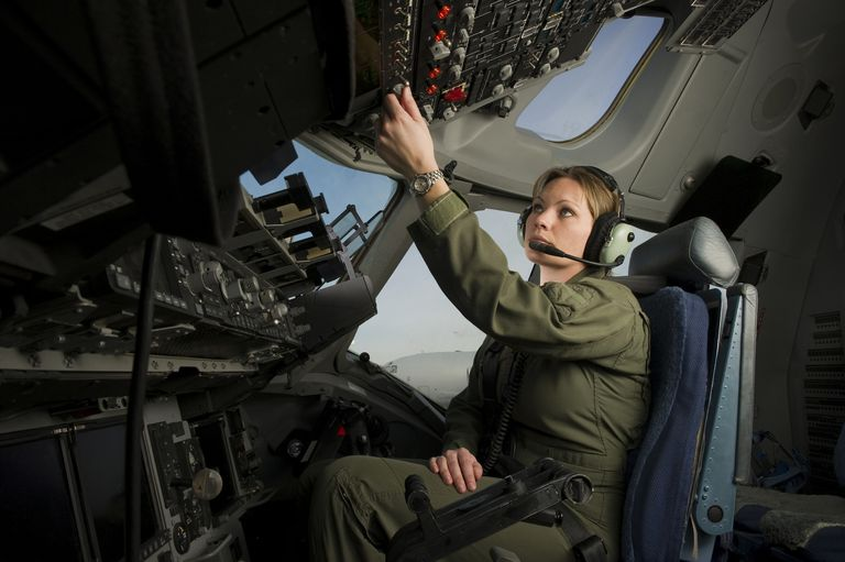 A U.S. Air Force pilot conducts her preflight checklist during engine start up on the flight deck.