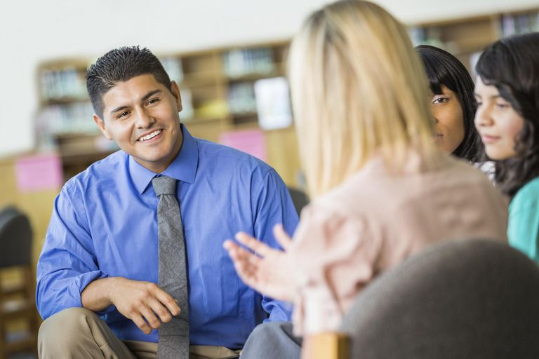 Hispanic counselor discussing something during group therapy session
