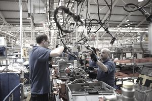 Men working on parts in a factory