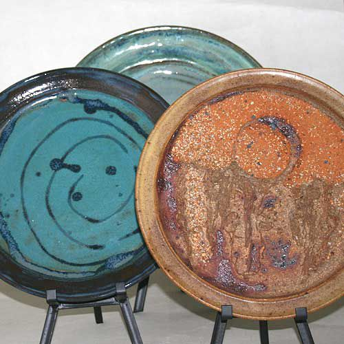 Three plates thrown on the potter's wheel.