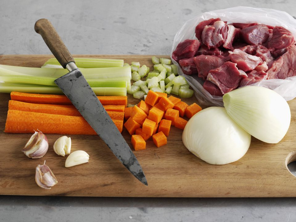 Meat and vegetables on chopping board