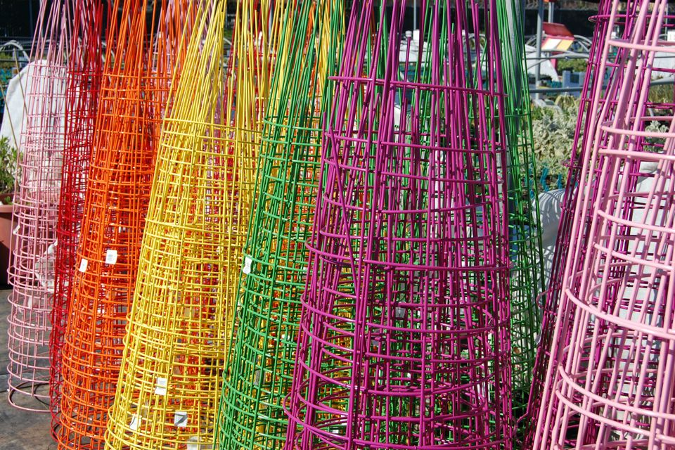 tomato cages in a rainbow of colors