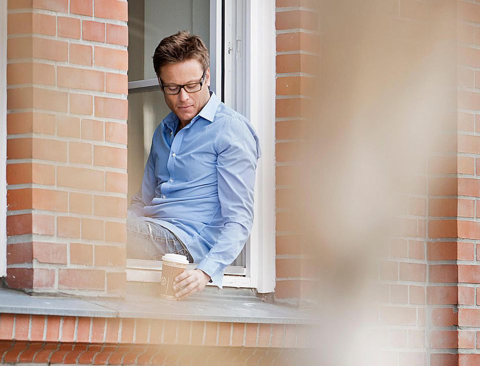 Man sitting in apartment window