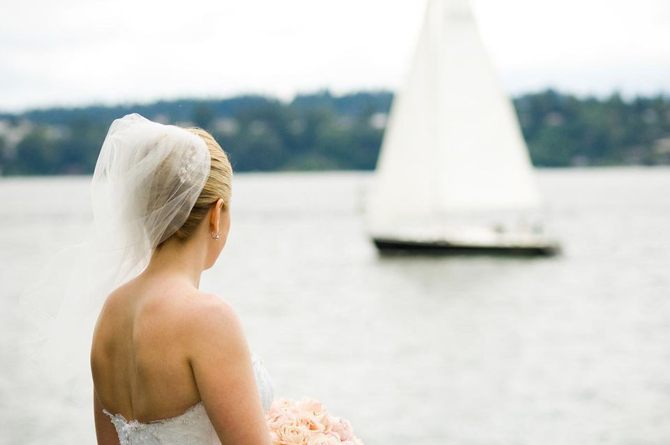 Bride with lake and sailboat in background