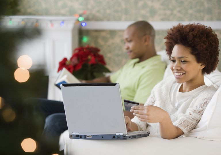 Mixed race woman buying Christmas presents online with credit card