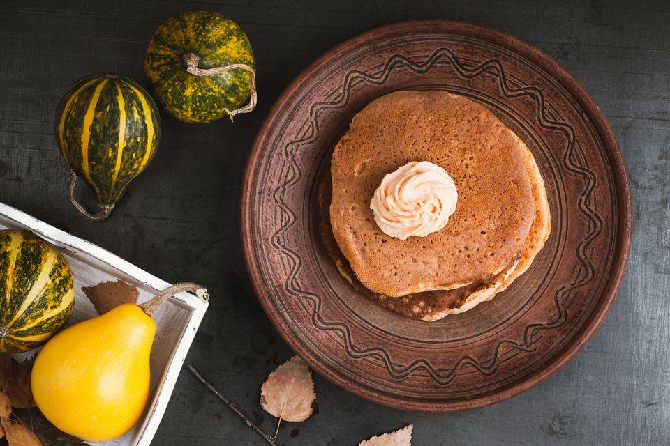 Homemade pumpkin pancakes with pumpkin buttercream frosting