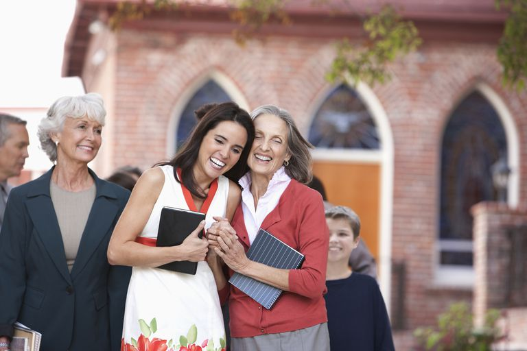 friends smiling and walking out of church