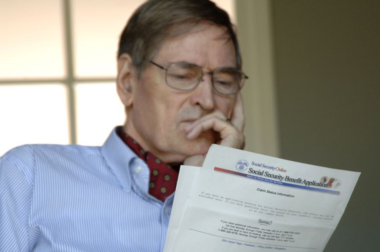 Man looking at application for Social Security benefits.