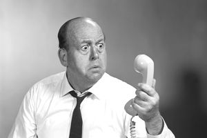 1960s BALDING MAN LOOKING ANGRY INTO TELEPHONE RECEIVE