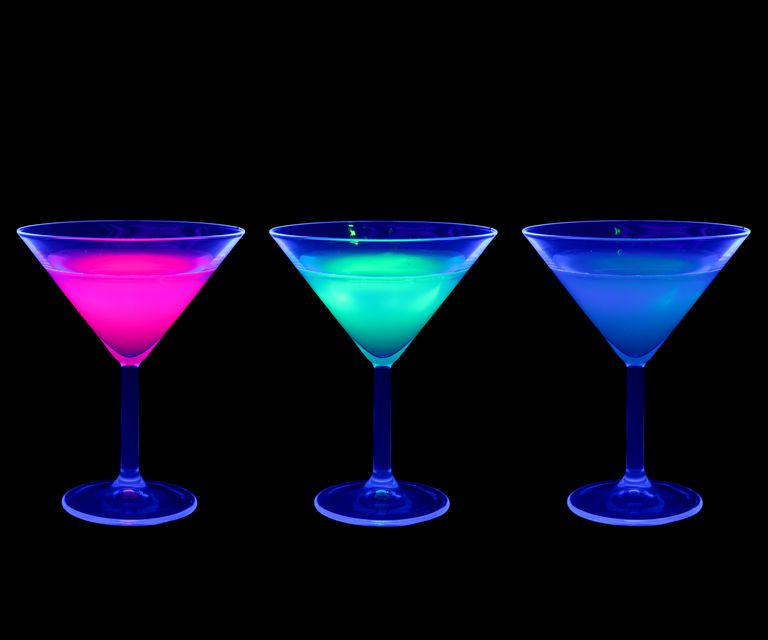 Tonic water and some liqueurs glow under a black light.
