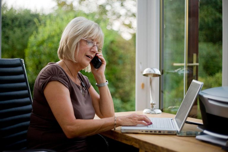 Mature woman working at home