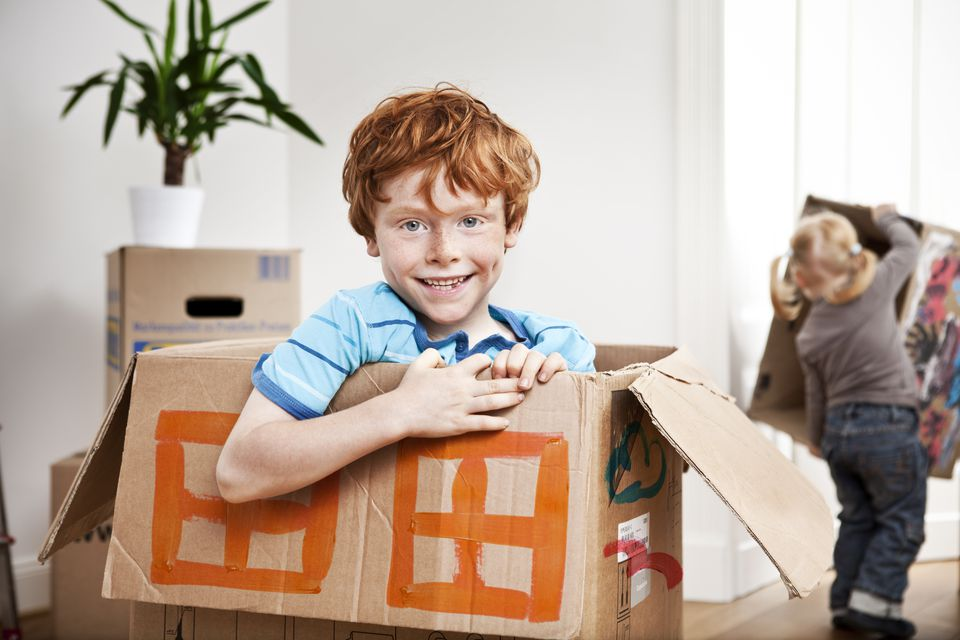 Young boy playing with moving boxes