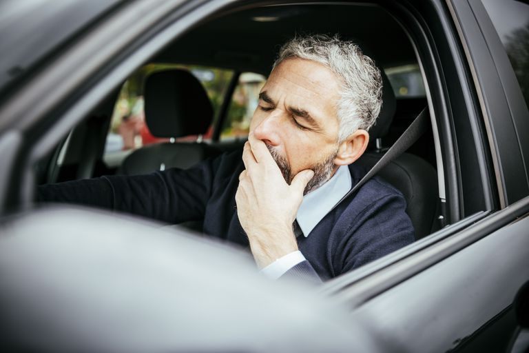 Tired man driving car