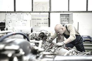 Worker Repairing Complex Machine