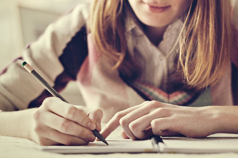 Girl writing notes in her notebook