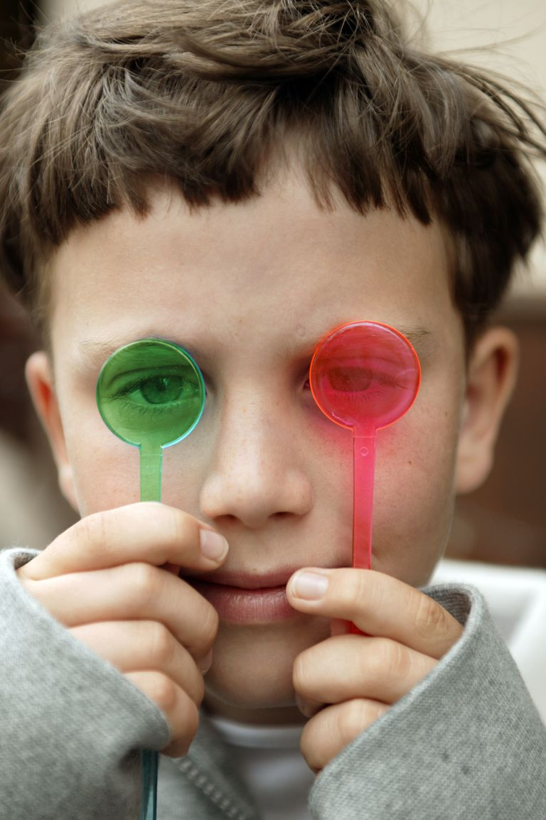 Boy Holds Red and Green to Eyes
