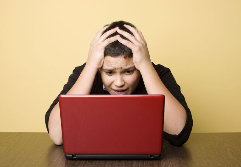 frustrated student at a laptop